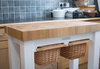 Aruba Grande Butcher Block Table with Wicker Baskets